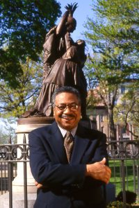 Clement Price in Lincoln Square, Newark, in the city's Central Ward, where the civil disturbances of 1967 concentrated a nd where he lived for three decades, 1997. Photograph by Arthur Paxt on, courtesy Rutgers Newark.
