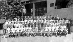 This photograph of the class of 1942, P.S. 23, New York City, displayed in the 1987 Salvaging New York Chinatown exhibit, sparked memories among former students and teachers. leading to a series of reunions at the New York Chinatown History Project. Courtesy Museum of Chinese in America (MOCA).