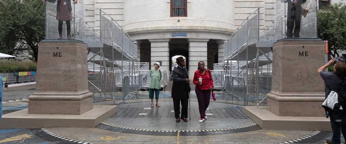 People walking outside of a public monument in philadelphia