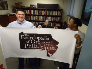 Photograph of students holding banner for the Encyclopedia of Greater Philadelphia